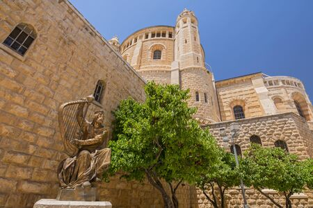 King David of Israel playing the harp. Statue located near the entrance to the king David's Tomb on Mount Zion in Jerusalem, Israel.