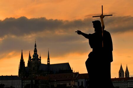 Prague Castle and Statue on the Charles Bridge in Prague, Czech Republic.