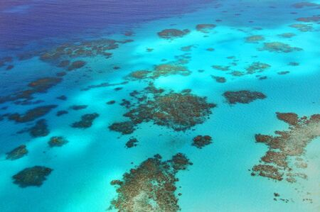 Aerial view of Great Barrier Reef from helicopter, Queensland, Australia.