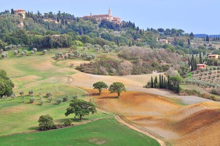 Tuscan landscape with view of Pienza, Val d'Orcia, Tuscany, Italy. Stok Fotoğraf