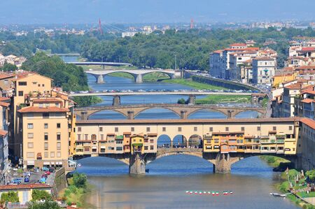 The Ponte Vecchio from the north side of the River Arno, Florence, Tuscany, Italy.