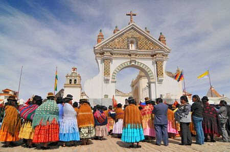 Bolivia, Copacabana, Typical Traditional Bolivian Women near Basilica Nuestra Senora de Copacabana. Stock Photo