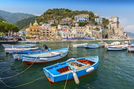 Leisure boats and traditional buildings in Cetara harbor, Amalfi coast, Italy.