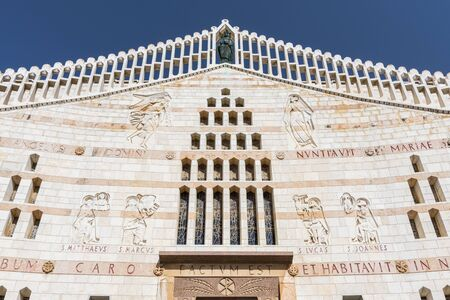 The beautiful facade of the Basilica of Annunciation with stone carvings, in Nazareth, Israel.
