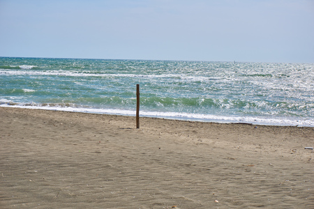 wooden post: beach and blue sea with wooden post
