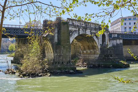 over grown: Bridge over tiber with grown over ruins Stock Photo