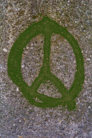 green peace: graffiti forming a green peace sign on urban stone wall
