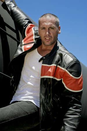 male fashion model: Modelo de moda masculina en tren Foto de archivo