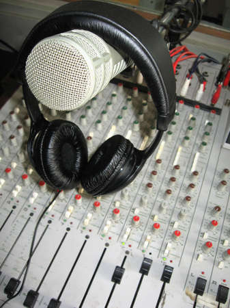 Radio studio detail: microphone, headphones and mixer