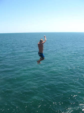 Man jumping in the sea