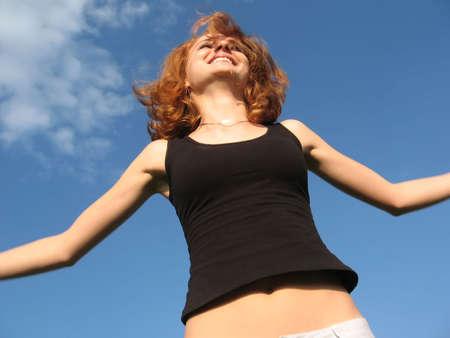 Beautiful woman jumping happy
