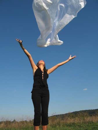 Beautiful woman playing with white silk