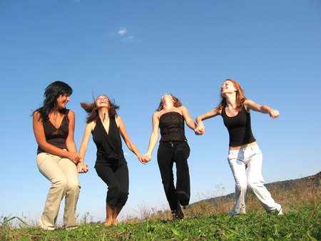 Group girl friends preparing to jump Stock Photo