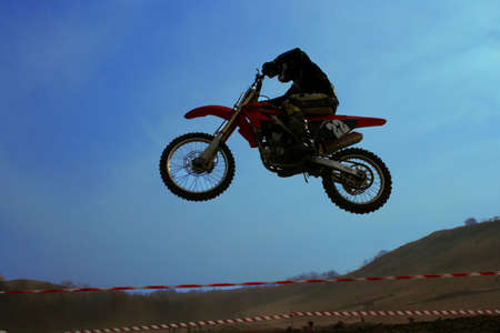 Sportsman flying on his offroad motorbyke Stock Photo