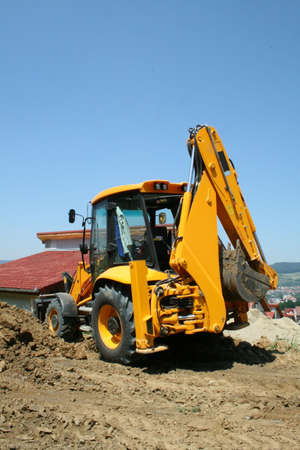 Excavator on a site in a new residential area
