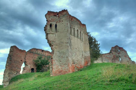 Old fortress on a hill with dramatic clouds in background - HDR image Stock Photo - 1789371