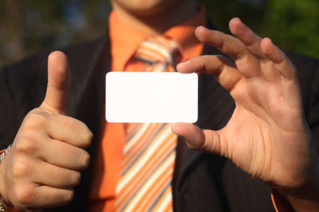 Business man holding a white card with copyspace Stock Photo