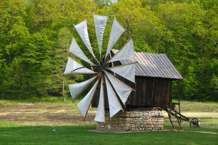 Retro windmill in an open air museum photo