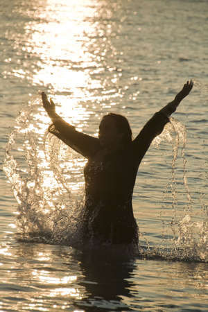 Wet woman playing with water in sunrise Stock Photo - 5499774