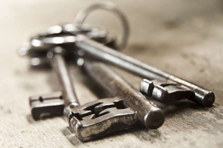 three objects: Three old keys on a ring Stock Photo