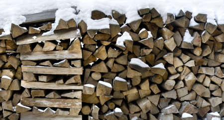 Pile of firewoods in winter ready to be put in fire Stock Photo - 8899125