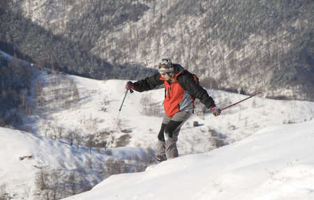 offpiste: Young man skiing with backpack on a free ride