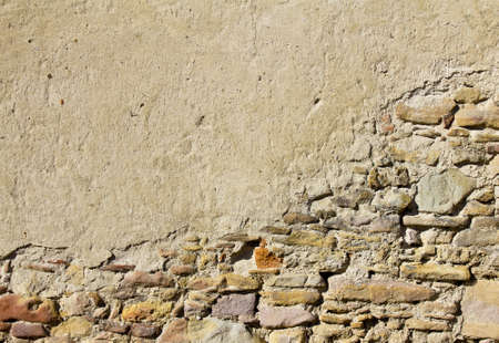 Old wall texture with bricks and stones uncovered Stock Photo - 12796847