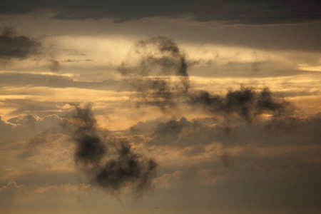 loosen up: Dramatic clouds in a late evening after a rainshower