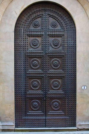 metal door: Old wooden door with a lot of iron nails in Tuscany  Italy