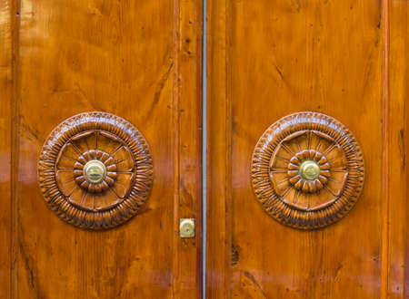 Old wooden door with a lock in Italy photo