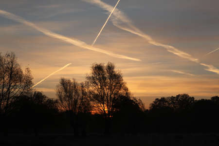 vapour: Sunrise vapour trails Stock Photo