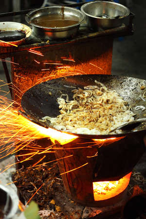 fried noodle: char kway teow cooked over a charcoal stove