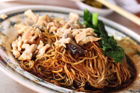 Black sauce wanton noodles with chicken slices