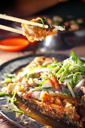 Fried fish with herbal sauce Stock Photo