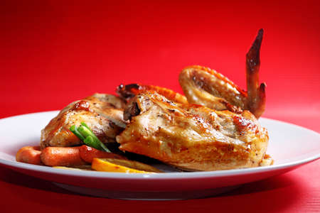 Roast chicken on a red background Stock Photo