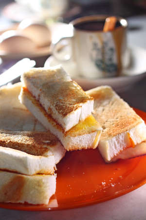 The toasted bread with a layer of butter   kaya spread