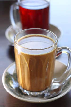 Teh Tarik, a hot Malaysian tea beverage Stock Photo