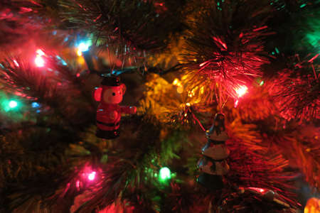 A Christmas ornament is about to hug a tree ornament.