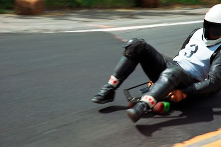 toboggan: racing downhill with speed skateboard or toboggan
