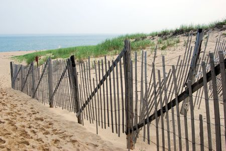 beachcomb: Cape Cod beach landscape with wood fence