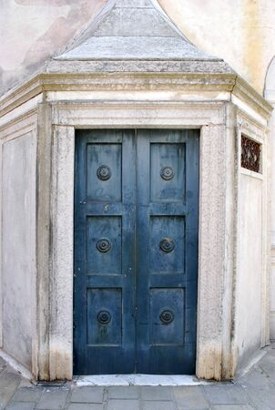 front entry: Old colored wood door closeup and handle