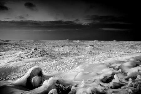 wintery: Wintery Sunset on Lake Huron Shore in monochrome