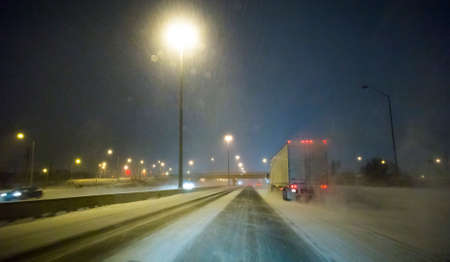 roadway: Driving an Icy Winter Roadway Stock Photo