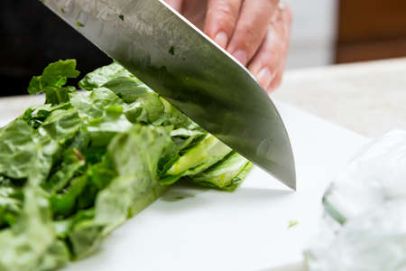 homestyle: Cutting Lettuce for Salad at Home Stock Photo