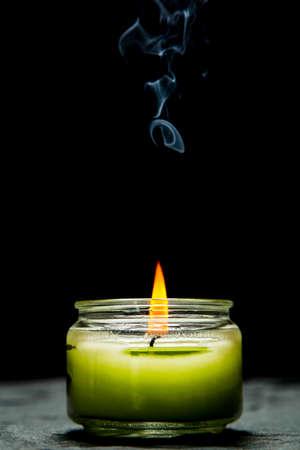 dark: Candle on Dark Background Stock Photo