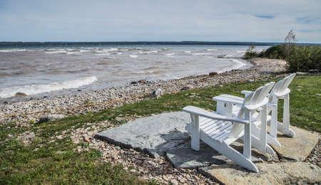 muskoka: Muskoka Chairs by the waters edge for scenic view