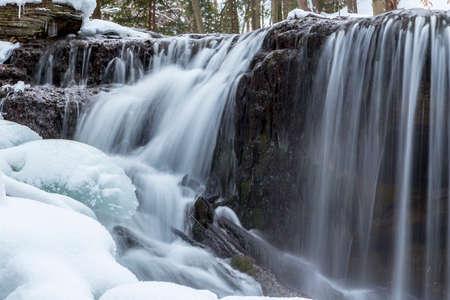 sub zero: flowing waterfalls in winter, owen sound ontario, weavers creek