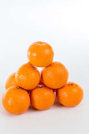 clementines: Bright Orange Clementines on a bright background Stock Photo