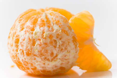 clementine fruit: Closeup on Orange Clementines in Bright Studio Stock Photo