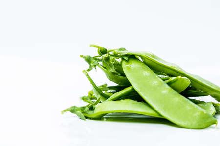 snap: Fresh Green Sugar Snap Peas on a Bright Background